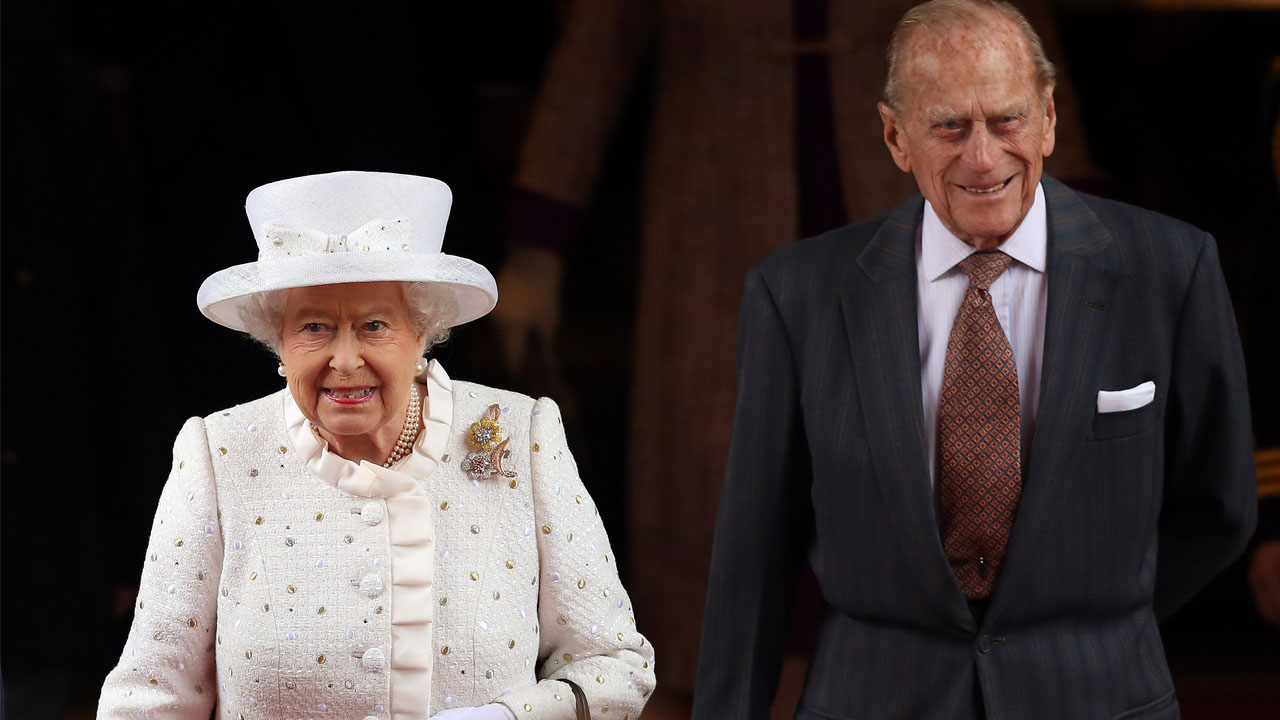 (FILES) This file photo taken on June 24, 2015 shows Britain's Queen Elizabeth II and her husband Prince Philip, The Duke of Edinburgh, as they  arrive at the Adlon Hotel in Berlin. Queen Elizabeth II will celebrate her 90th birthday on April 21, 2016, with a family gathering and a cake baked by a reality television star, as a new poll finds Britain's longest serving monarch is as popular as ever. The queen has reigned for more than 63 years and shows no sign of retiring, even if she has in recent years passed on some of her duties to the younger royals.  / AFP PHOTO / Ronny HARTMANN