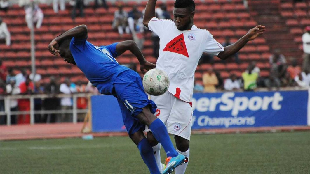 Enugu Rangers' Orji Kalu battling with t Andrew Abalogu of Enyimba in a recent game. Rangers held MFM to a 1-1 draw in Lagos PHOTO: LMC.