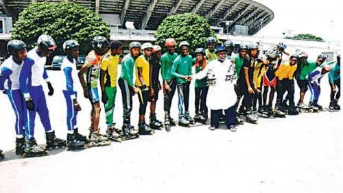 President of Nigeria Roller Skating Federation, Comrade Joseph Evah (middle), with some of the skaters after the inauguration of the federation at the National Stadium, Lagos… last week.