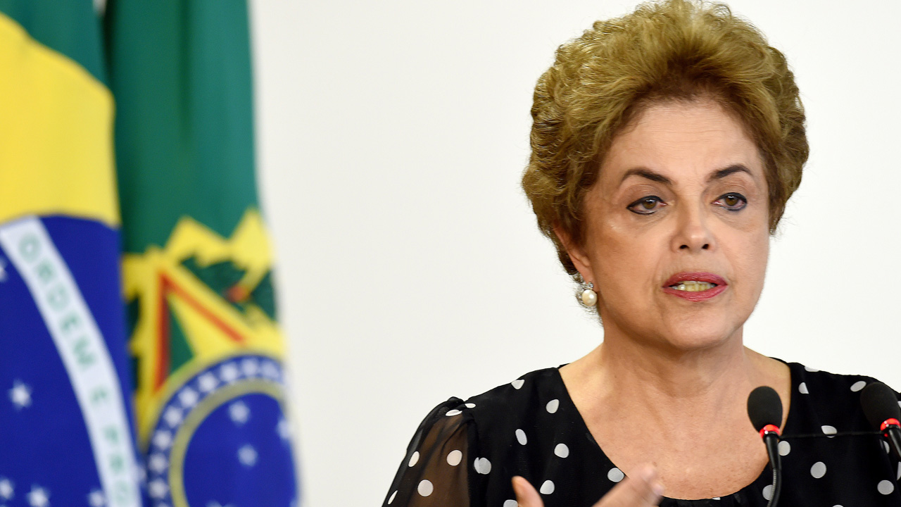 "Brazilian President Dilma Rousseff attends a ceremony to renovate the leasing contract regarding the use of the Paranagua Container Terminal, at Planalto Palace in Brasilia, on April 13, 2016. Brazil's President Dilma Rousseff vowed Wednesday she will ""fight to the last minute"" against efforts to impeach her, despite key allies deserting her as she clings to office. Lawmakers will hold a crucial vote on impeachment proceedings against Rousseff in congress on Sunday. / AFP PHOTO / EVARISTO SA"