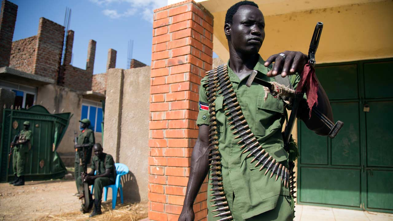 "A member of the Sudan People's Liberation Army in Opposition (SPLA-IO) stand guard at the military site in Juba, after the arrival of new troops and their chief of staff on April 25, 2016. Rebel spokesman William Ezekiel said that 195 troops landed along with South Sudan's top rebel military commander Simon Gatwech Dual, to provide security for Machar, who he said hoped to return on April 26. Some of the rebel troops looked visibly nervous, but others were more cheerful and raised fists into the air as their leader shouted ""Viva SPLA, viva SPLM!"" -- the acronym for the army and ruling party divided by the war. Albert Gonzalez Farran / AFP"
