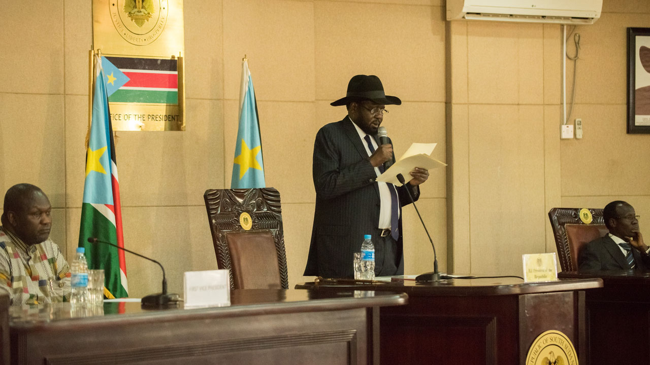 President Salva Kiir (C) delivers a statement as former rebel leader and new vice-president Riek Machar (L) listens during a ceremony at the Presidential House in Juba after Machar was sworn in as new vice-president, following hus arrival at Juba international airport on April 26, 2016. The return of rebel leader Riek Machar to Juba must pave the way for a genuine transition to end more than two years of brutal civil war in South Sudan, the UN peacekeeping chief said on April 26.  / AFP PHOTO / Charles Lomodong