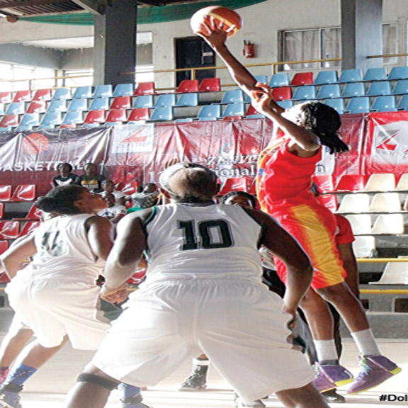 Dolphins women basketball team slugging it out with their Customs counterparts in the on-going second phase of Zenith Bank basketball championship in Asaba, Delta State.