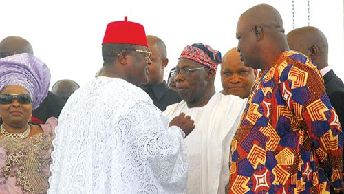 Ebonyi State Governor David Umahi, chatting with former President Olusegun Obasanjo (centre) during the burial of his mother in Uburu… yesterday. With them are wife of former President Goodluck Jonathan, Patience; and former Secretary to the Government of the Federation (SGF), Chief Anyim Pius Anyim.