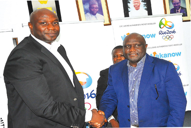 NOC's Secretary General, Tunde Popoola (right), and Wakanow's Managing Director, Obinna Ekezie, after signing the documents according the tour and hospitality firm the right as Nigeria's authorised ticket reseller for the Rio 2016 Olympics… on Tuesday.