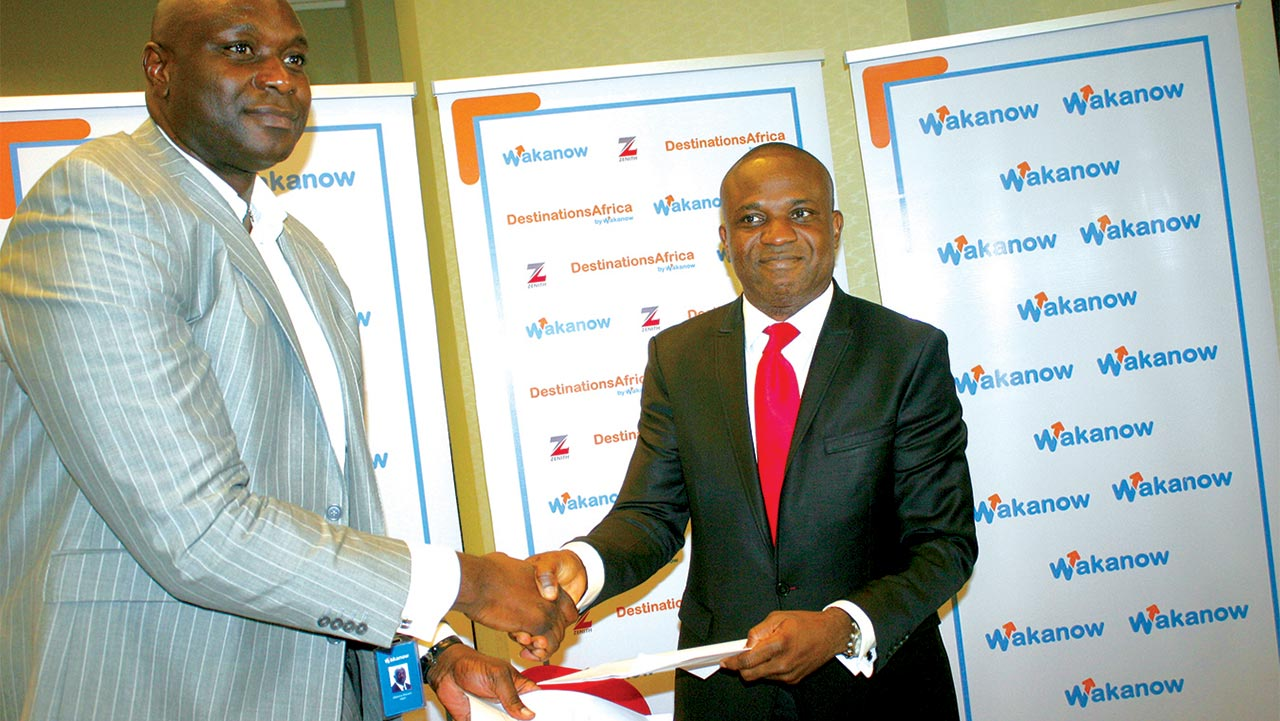 MD  and founder of Waknow, Obinna Ekezie (right) and Executive director, Zenith   Bank, Sola Oladipo after signing the MOU at the launch of the new brand of Wakanow in Lagos on Tuesday.