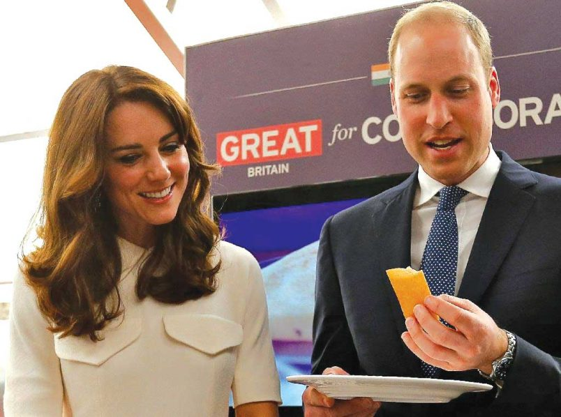 "Britain's Prince William, Duke of Cambridge, eating a ""dosa"", a traditional south Indian pancake, alongside his wife, Catherine, Duchess of Cambridge, during a Young Entrepreneurs Event in Mumbai…yesterday PHOTO: AFP"