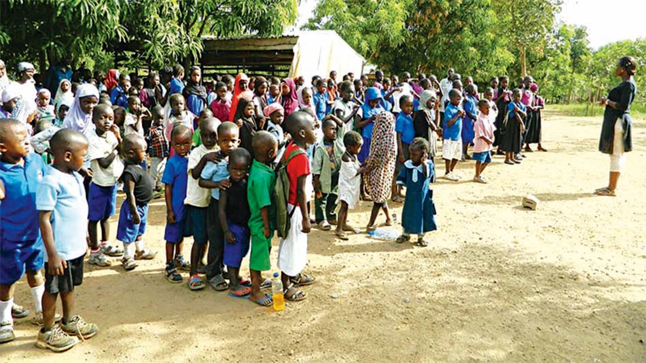 Programme Manager, Life Builders Initiative (LBI), Miss Timi Onafeso (right) addressing children of the Internally Displaced Persons (IDPs) from the 'School Without Walls' before their participation in an environmental sanitation exercise organised by LBI in commemoration of this year's World Malaria Day at Durumi camp in Abuja…yesterday. 												                                                                               PHOTO: NAN