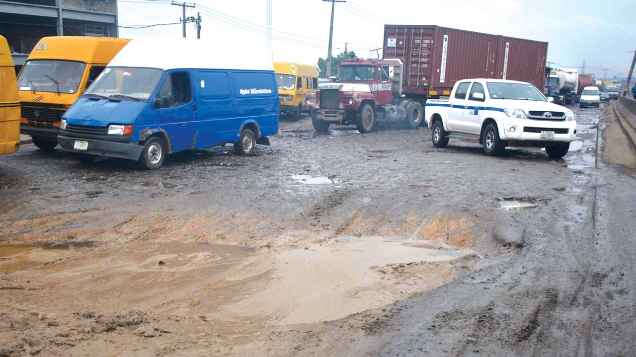 The deplorable state of Apapa-Oshodi Expressway by Itire bus-stop. PHOTOS: OSENI YUSUF