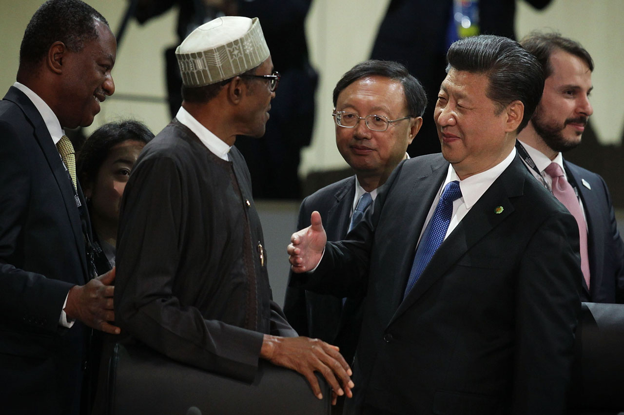 WASHINGTON, DC - APRIL 01: Chinese President Xi Jinping (R) greets President of Nigeria Muhammadu Buhari (L) during a plenary session of the 2016 Nuclear Security Summit April 1, 2016 in Washington, DC. U.S. President Barack Obama is hosting the fourth and final in a series of summits to highlight accomplishments and make new commitments towards reducing the threat of nuclear terrorism.   Alex Wong/Getty Images/AFP