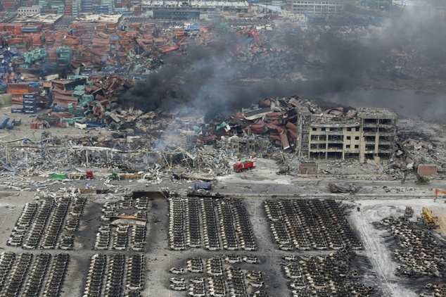 Smoke rises at the site of an explosion in Tianjin on August 14, 2015