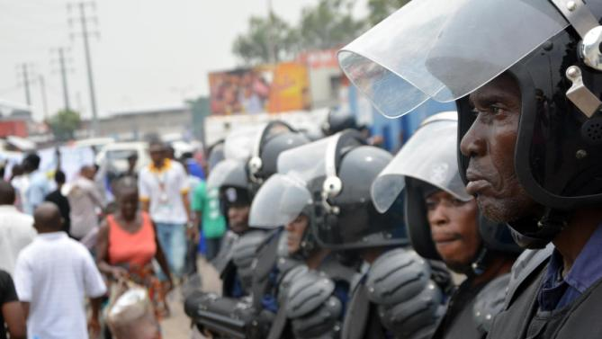 Police stand guard following demonstrations in Kinshasa, DR Congo, AFP
