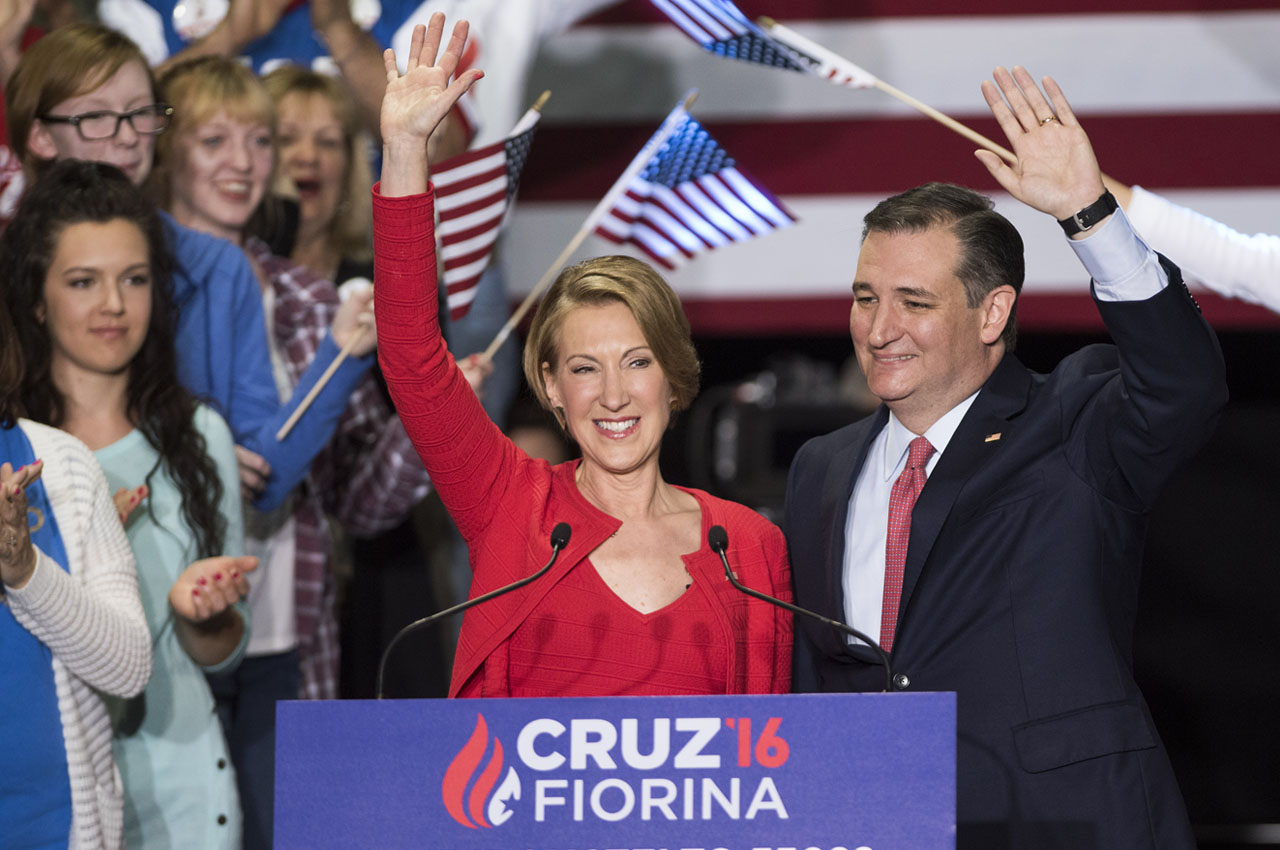 INDIANAPOLIS, IN - APRIL 27: Republican presidential candidate Sen. Ted Cruz (R-TX) (R) greets supporters with former Hewlett-Packard chief executive Carly Fiorina at a campaign rally in the Pavilion at the Pan Am Plaza on April 27, 2016 in Indianapolis, Indiana. Cruz named Carly Fiorina as his pick for Vice President running mate during the rally. Ty Wright/Getty Images/AFP