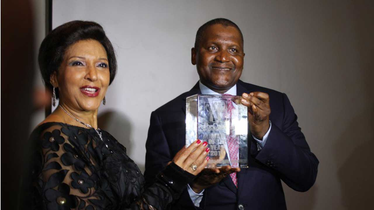 Chairman/Publisher of The Guardian newspapers, Lady Maiden Ibru presenting The Guardian Man Of The Year 2015 Award to President of Dangote Group, Alhaji Aliko Dangote, at the ceremony held at The Wheatbaker Lagos… yesterday. PHOTO: FEMI ADEBESIN-KUTI