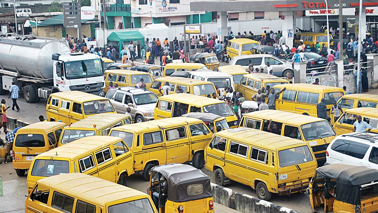 Queues at a Total filling station at Igando-Ikotun road, Lagos as the fuel scarcity lingers PHOTO: OSENI YUSUF