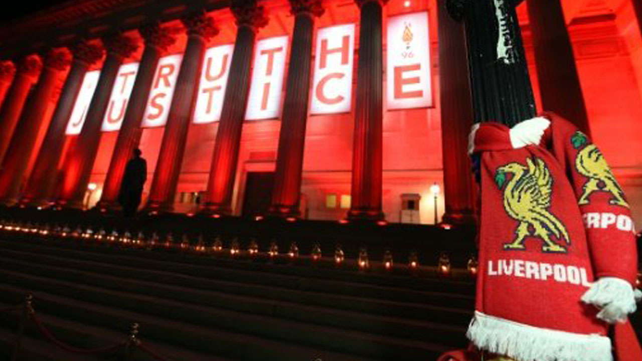 AFP / by Robin Millard | Flowers are laid and candles are lit on the steps of St Georges Hall in Liverpool on April 26, 2016, in remembrance of the 96 Liverpool fans who died in the Hillsborough stadium disaster