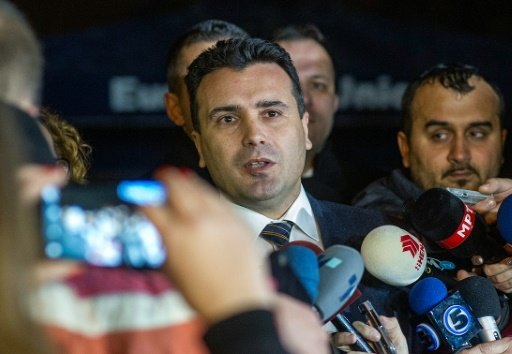 AFP/File | The leader of Macedonia's biggest opposition party SDSM, Zoran Zaev (C) talks to the media in Skopje on January 16, 2016
