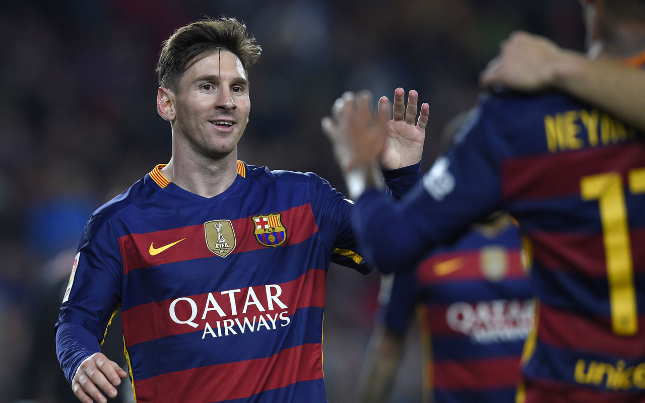 Barcelona's Argentinian forward Lionel Messi celebrates after scoring during the Spanish league football match FC Barcelona vs Real Sporting de Gijón at the Camp Nou stadium in Barcelona on April 23, 2016. / AFP PHOTO / LLUIS GENE
