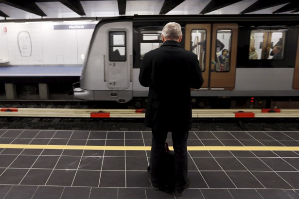 A commuter waits on a platform after the Maelbeek metro station reopened on Monday in Brussels, Belgium, April 25, 2016. REUTERS/Francois Lenoir - RTX2BIDT