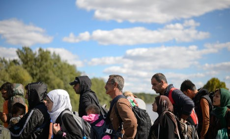 Migrants wait to cross the Slovenian-Austrian border in Gornja Radgona last September. Photo: Jure Makovec/AFP