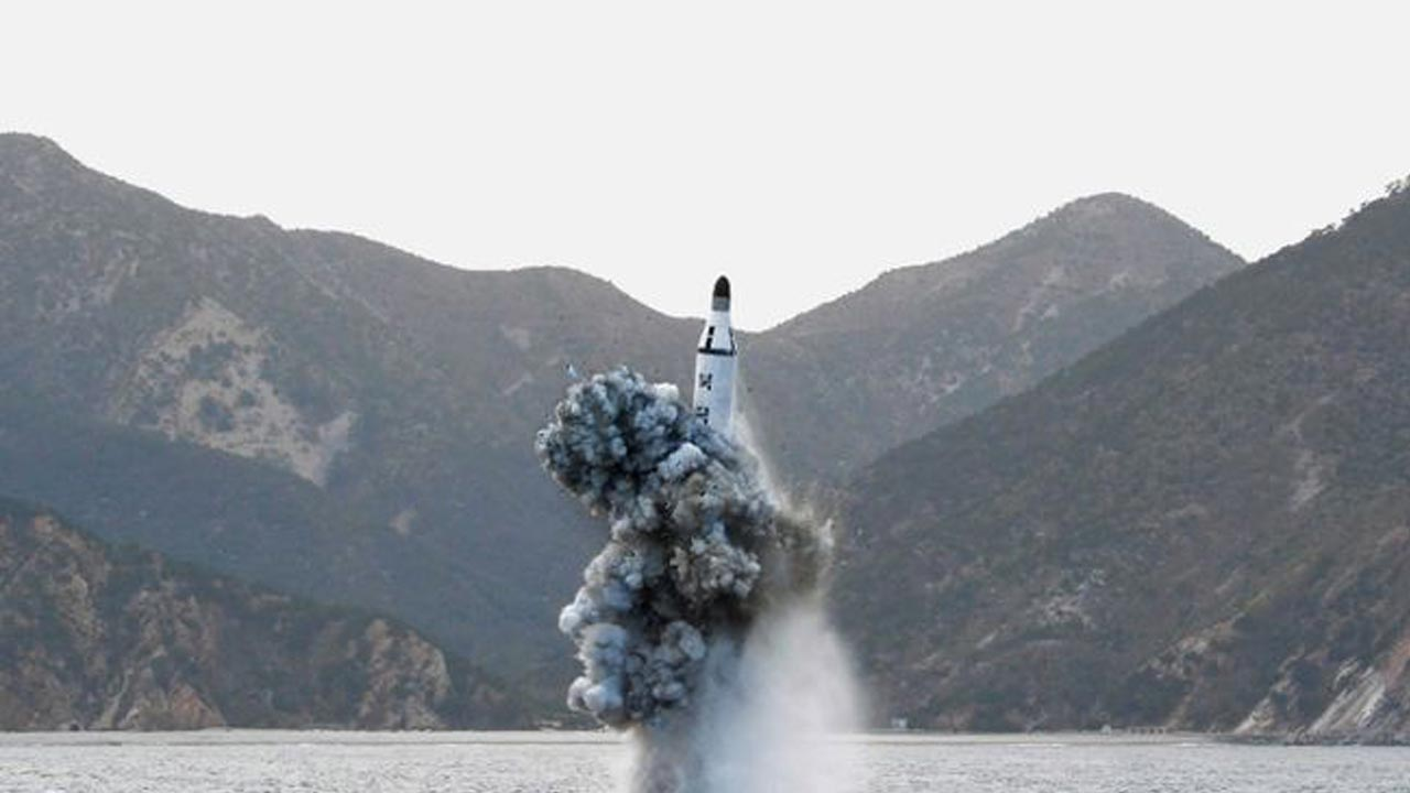North Korean leader Kim Jong Un guides on the spot the underwater test-fire of strategic submarine ballistic missile in this undated photo released by North Korea's Korean Central News Agency (KCNA) in Pyongyang on April 24, 2016. (KCNA/via REUTERS)