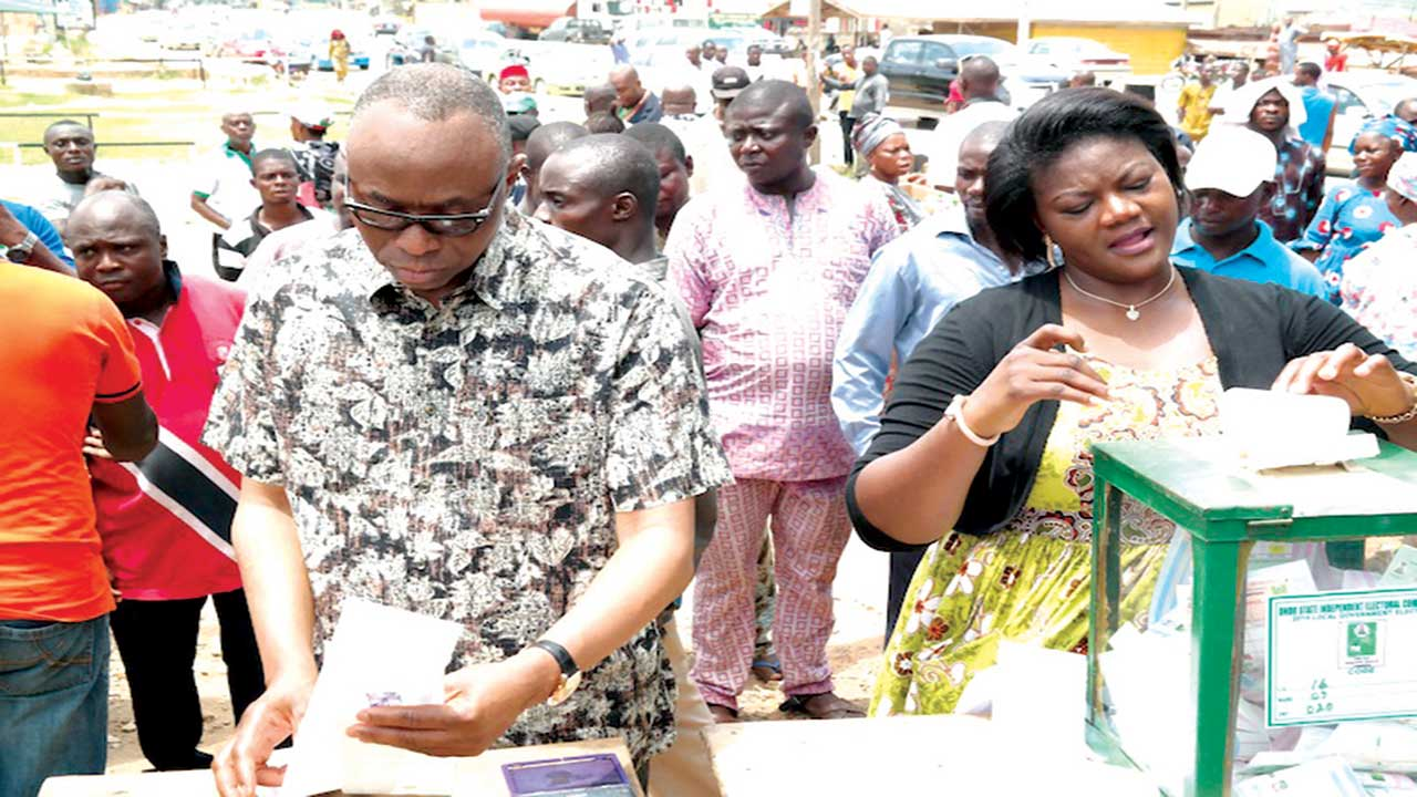 Dr. Olusegun Mimiko (left) and his wife, Olukemi (right), casting their votes at Ward 7, Unit 20, Yaba, in Ondo West LGA, during the Ondo Council Election, at the weekend.