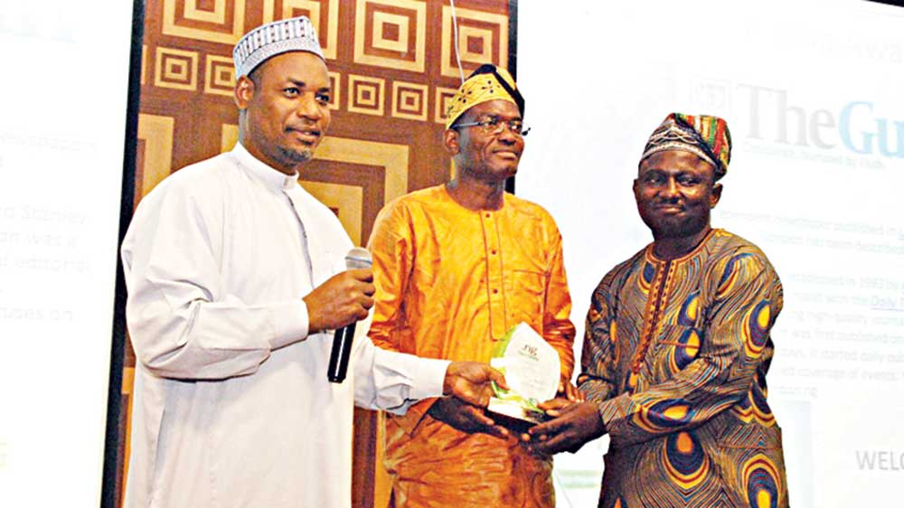 Director, Institute of Computer and ICT, Ado Bayero University, Prof. Sahalu B. Junaidu (left); member, Executive Board, Nigeria Internet Registration Association (NIRA), Mohammed  Sikiru Shehu and Senior System Analyst, The Guardian, Michael  Ajiboye during the presentation of .ng media excellence award in Lagos at the weekend                                          PHOTO: FEMI ADEBESIN-KUTI