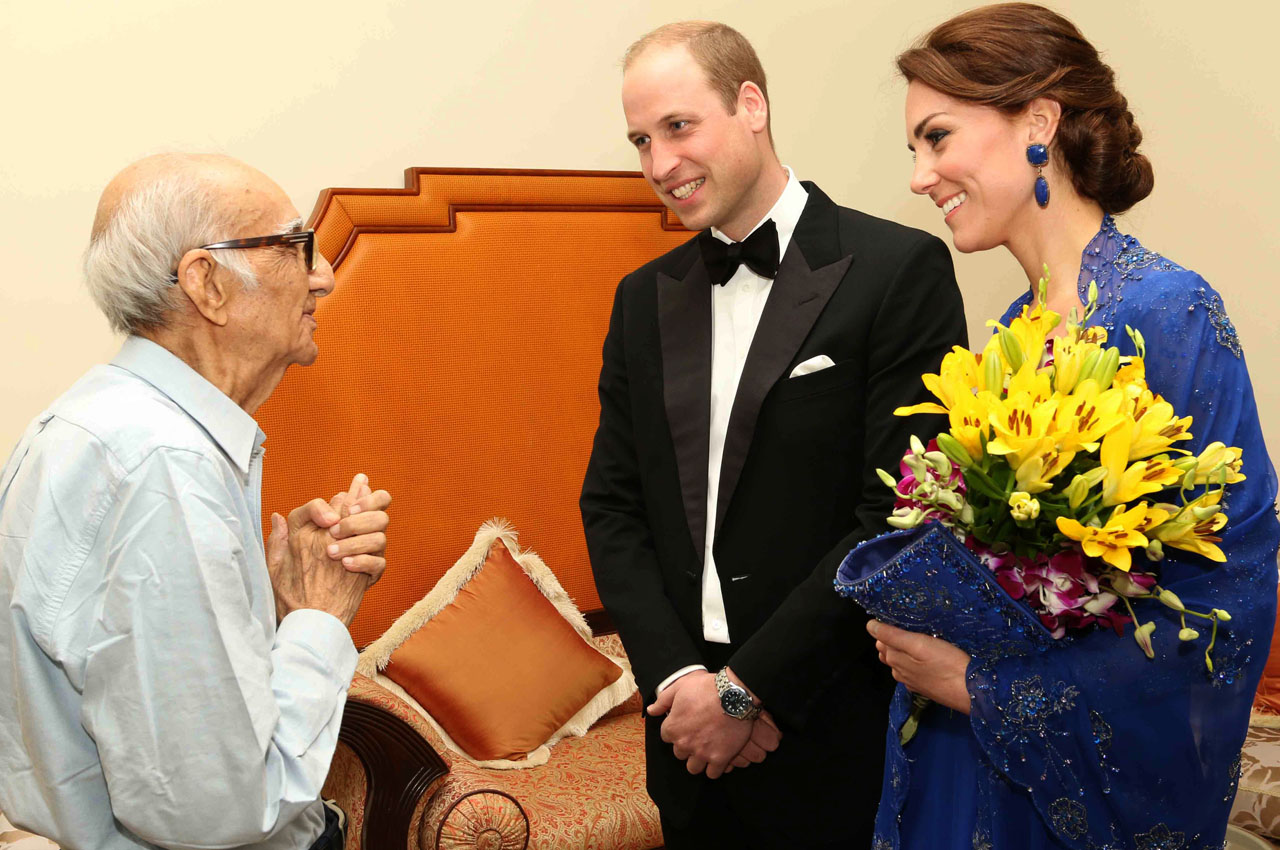 "In this handout photograph released by The British Deputy High Commission on April 11, 2016, Prince William, Duke of Cambridge(C)and Catherine, Duchess of Cambridge(R)speak with Boman Kohinoor(L) during a meeting in Mumbai on April 10, 2016. Kohinoor, 93, has a strong claim to be India's biggest fan of the British royal family -- giant cardboard cutouts of William and Kate adorn his restaurant -- and he told AFP that he was desperate to meet them. His dream came true after William and Kate were made aware of a social media campaign with the hashtag #WillKatMeetMe. / AFP PHOTO / BRITISH DEPUTY HIGH COMMISSION / HO / RESTRICTED TO EDITORIAL USE - MANDATORY CREDIT ""AFP PHOTO / BRITISH DEPUTY HIGH COMMISSION"" - NO MARKETING NO ADVERTISING CAMPAIGNS - DISTRIBUTED AS A SERVICE TO CLIENTS"