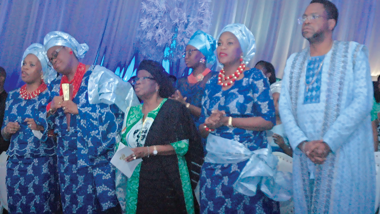 The Braithwaite family, Oluyele his first son (right), Omowunmi, the widow, Dr. Grace Braithwaite, Olaoluwa and Ebun during the service of songs