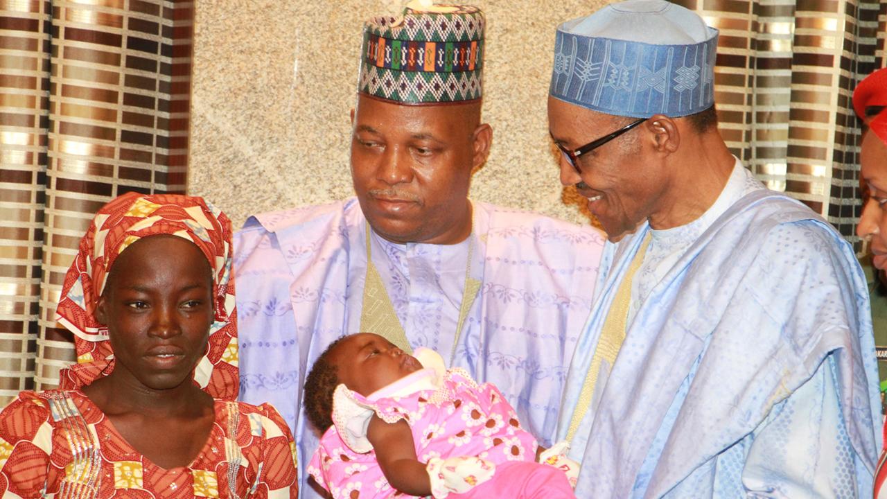 Rescued Chibok girl, Amina meets Buhari