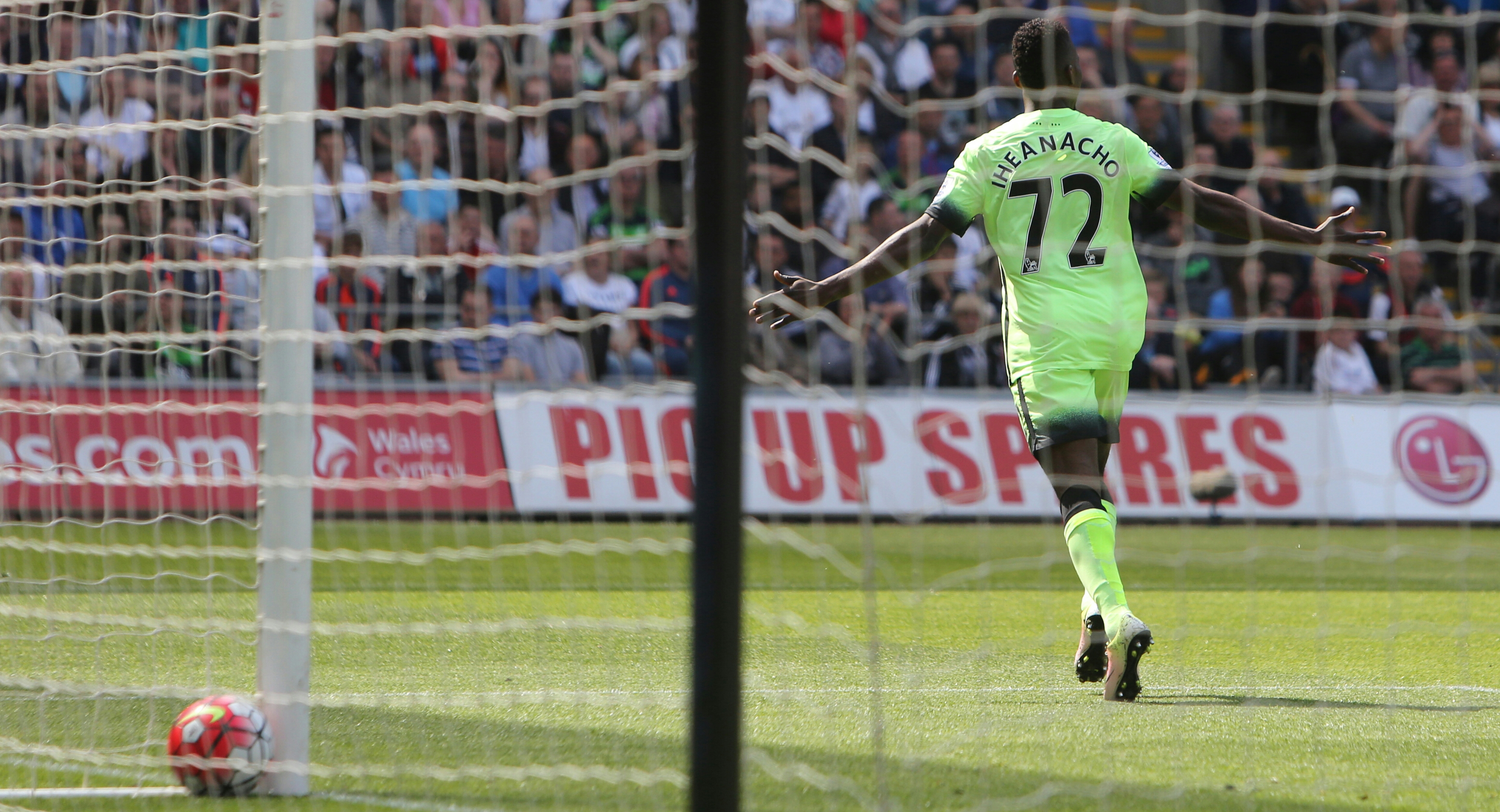 Manchester City's Nigerian striker Kelechi Iheanacho celebrates after scoring the opening goal of the English Premier League football match between Swansea City and Manchester City at The Liberty Stadium in Swansea, south Wales on May 15, 2016. The game finished 1-1.GEOFF CADDICK / AFP