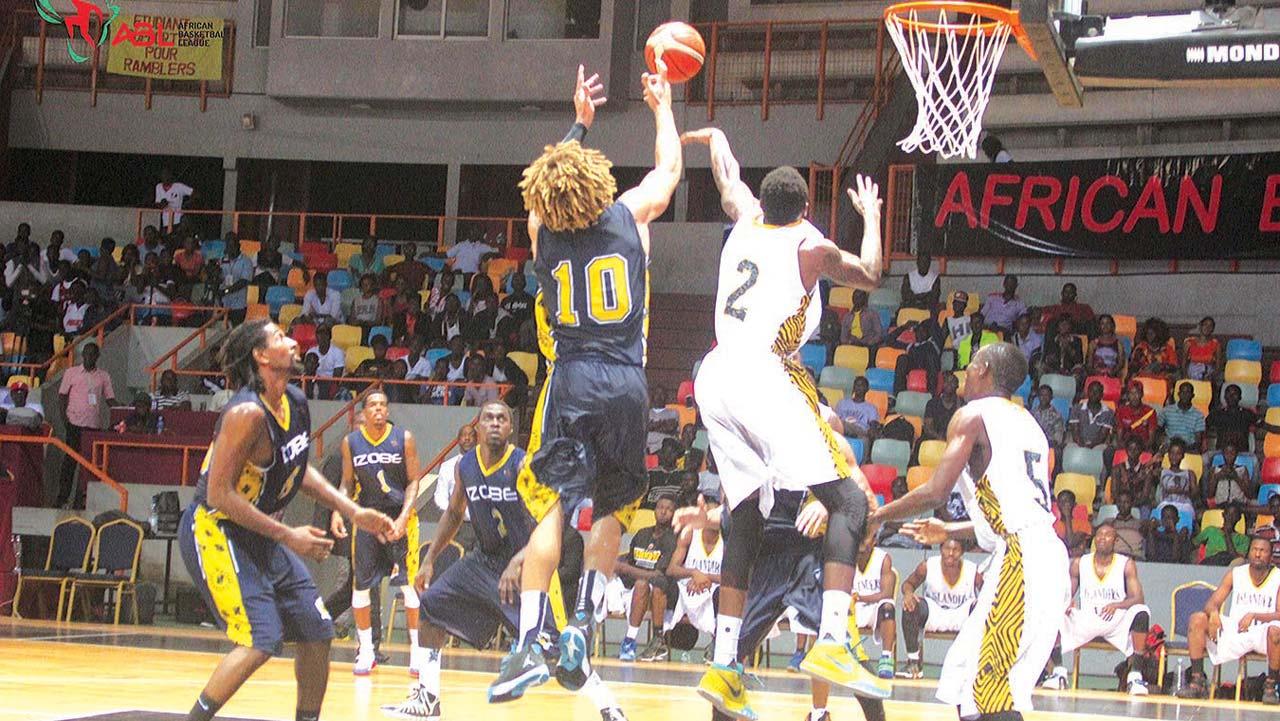 Lagos Islanders battling with Izobe of Gabon in an African Basketball League match at Palais des sports de Treichville, Abidjan.…recently.