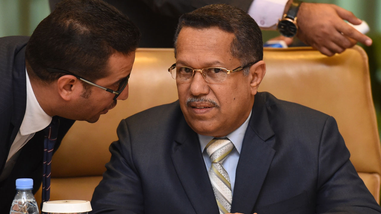 Yemeni Prime Minister Ahmed bin Dagher (R) listens to his aide during a cabinet meeting of Yemeni ministerial council held in the Saudi capital Riyadh, on May 18, 2016. Dagher, former secretary general of the General People's Congress party to which Yemen's President Abedrabbo Mansour Hadi once belonged, was named as prime minister by Hadi in April. Iran-backed rebels have been in control of capital Sanaa since 2014, forcing the government to declare second-city Aden as temporary capital. But Hadi and many government officials, including Bahah, spend most of their time in Riyadh as they struggle to secure Aden and other parts of the country where Sunni jihadists have gained ground.  / AFP PHOTO / FAYEZ NURELDINE