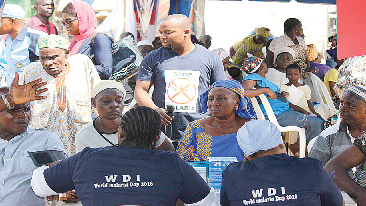 Alimosho Community members receiving free malaria treatment powered by Westfield Development Initiative in Lagos…recently.