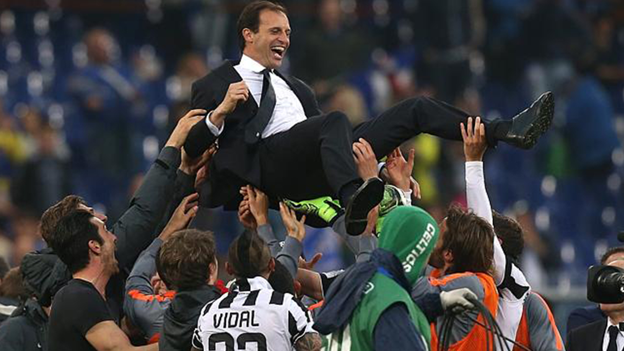 Juventus' players celebrate with their coach Massimiliano Allegri. Source: MARCO BERTORELLO / AFP