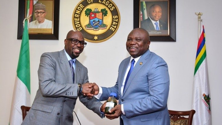 Lagos State Governor, Mr. Akinwunmi Ambode (right), receiving a sample of the Crude Oil discovered in the State by the Group Managing Director, Tunde Folawiyo Petroleum Company Limited, Mr. Tunde Folawiyo. PHOTO: Lagos State government