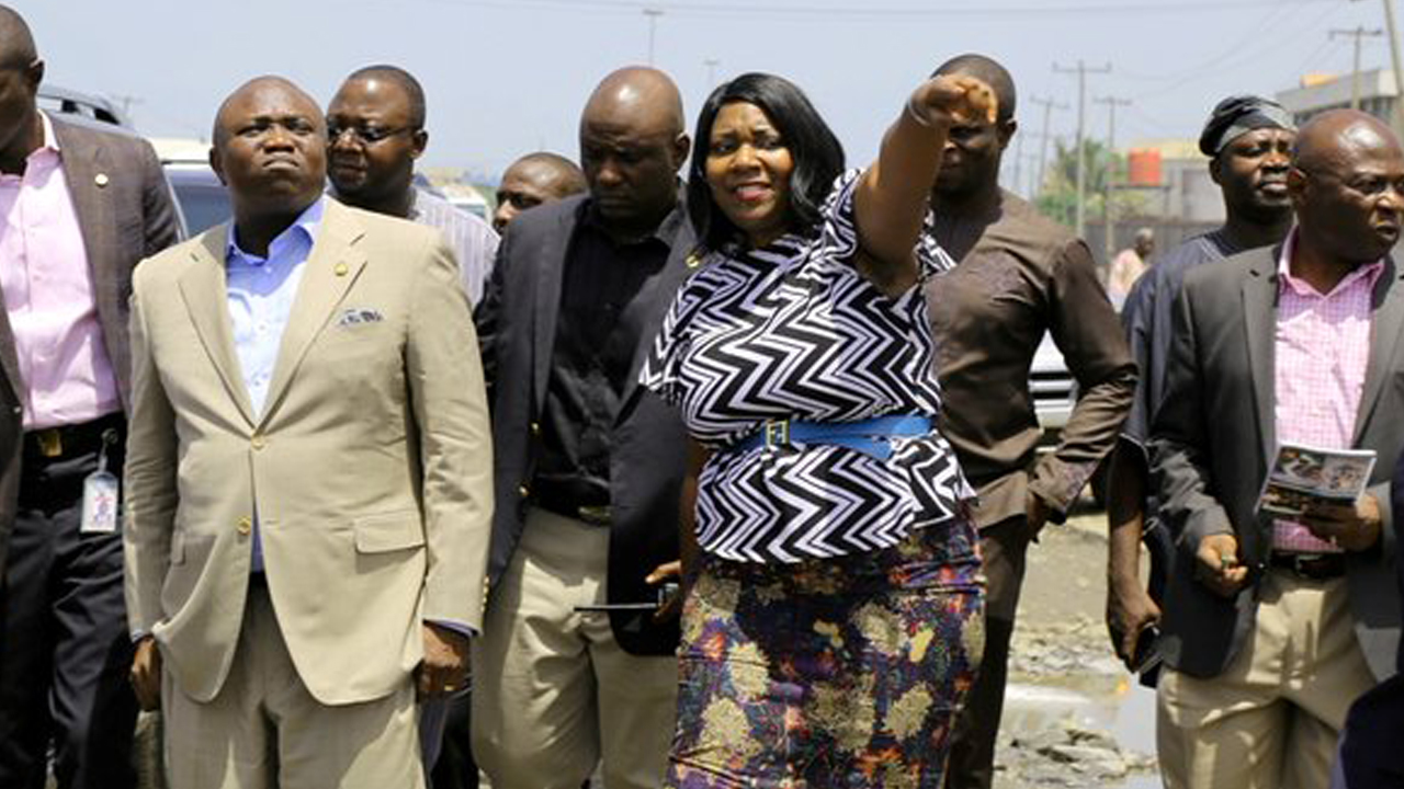 L-R: Lagos State Governor, Mr. Akinwunmi Ambode; Managing Director, Lagos State Waterways Authority (LASWA), Engr. Abisola Kamson and Commissioner for Waterfront Infrastructure Development, Engr. Adebowale Akinsanya during the Governor's inspection of the bad portion of Berlett Bus Stop on Apapa- Oshodi Expressway, Lagos, on Friday, May 13, 2016. PHOTO: LASG