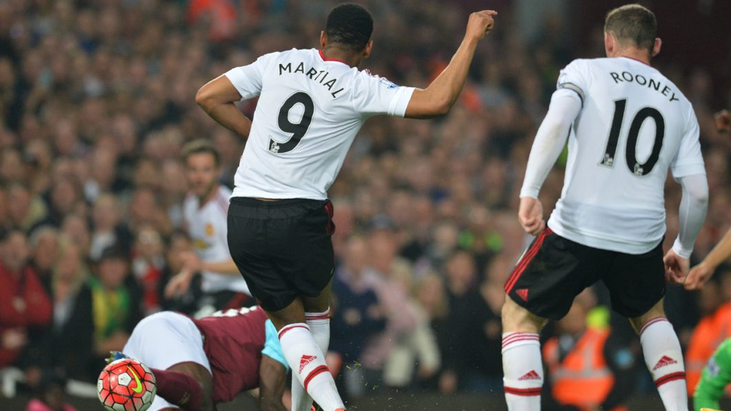 Manchester United's French striker Anthony Martial (C) shoots and scores their first goal during the English Premier League football match between West Ham United and Manchester United at The Boleyn Ground in Upton Park, in east London on May 10, 2016. / AFP PHOTO / GLYN KIRK