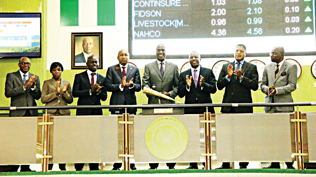 Head, Secondary Market, The Nigerian Stock Exchange (NSE) Dipo Omotoso, (left); Company Secretary, Berger Paints Nigeria Plc, Oluseun Oluwole; Corporate Strategy & Risk Management, Berger Paints Nigeria Plc, Oluwaseun Daini; Executive Director, Capital Market, NSE, Haruna Jalo-Waziri; Non-Executive Director, Berger Paints Nigeria Plc, Abi Allison Ayida; Managing Director, Berger Paints Nigeria Plc, Mr. Peter Folikwe; General Manager, Finance, Berger Paints Nigeria Plc, Kola Ajayi, and Olumide Lala, Head, Transformation and Change, NSE, at Berger Paints Nigeria Plc Facts Behind the Figures presentation at the Exchange on Monday.