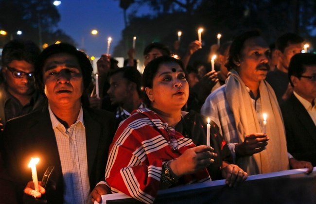 Bangladeshi people hold lighted candles and walk in a rally during Martyrs Day in Dhaka, Bangladesh on Dec. 14, 2015. The slaying in Bangladesh of a U.S. Agency for International Development employee has intensified U.S. concern that the strategically located South Asian country with traditions of religious tolerance is under threat from Islamic extremists. (AP Photo/A.M.Ahad)