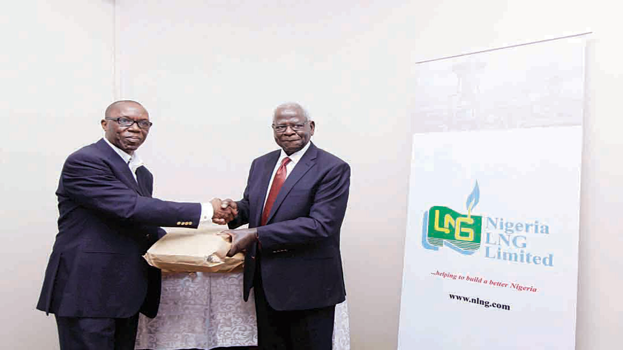 Prof. Ayo Banjo receiving this year's entries for The Nigerian Prize for Literature from Nigeria Liquefied Natural Gas (NLNG) company, Manager, Communications and Public Affairs, Mr. Tony Okonedo recently… in Lagos
