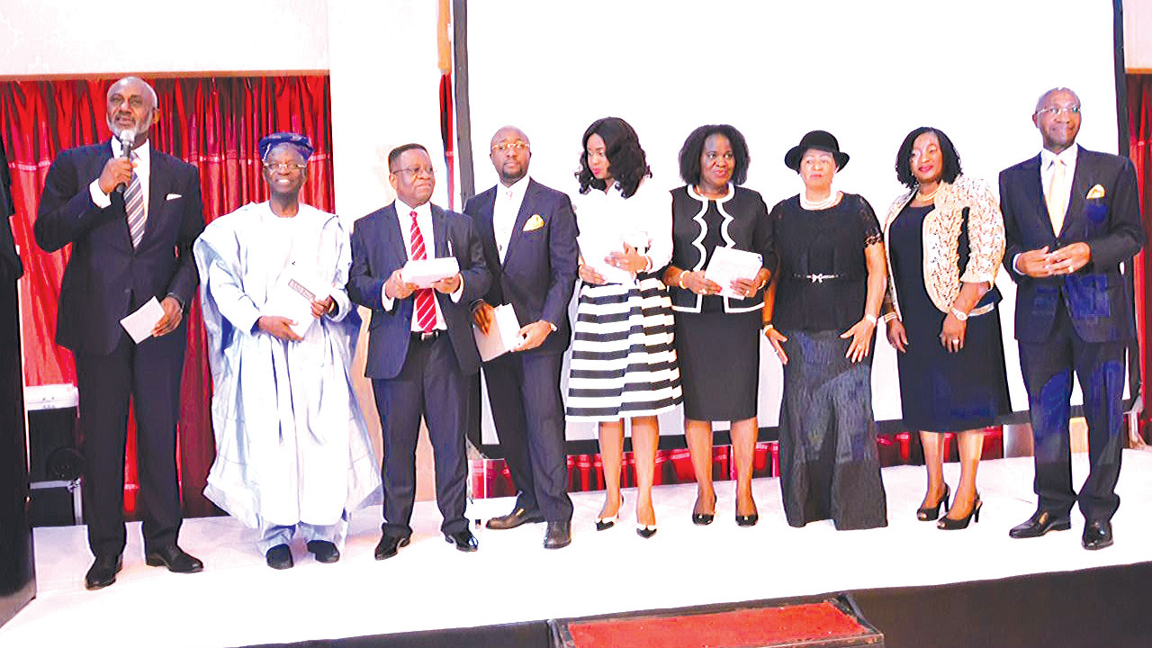 "Book presenter, Gbenga Oyebode, (left); chairman of the occasion, Prof Gabriel Olawoyin (SAN); Justice of the Supreme Court, John Inyang Okoro; author of the book, Dr. Oladapo Olanipekun (SAN); his wife, Winnifried; Justice of the court of appeal, Justice Chidi Uwa; Justice Chinwe Iyizoba of the court of appeal Lagos; author's mother, Mrs Omolara and father, Chief Wole Olanipekun (SAN) at the presentation of the book; ""Banking: Theory, Regulation, Law and Practice at the Oriental Hotel Lagos Wedneday."
