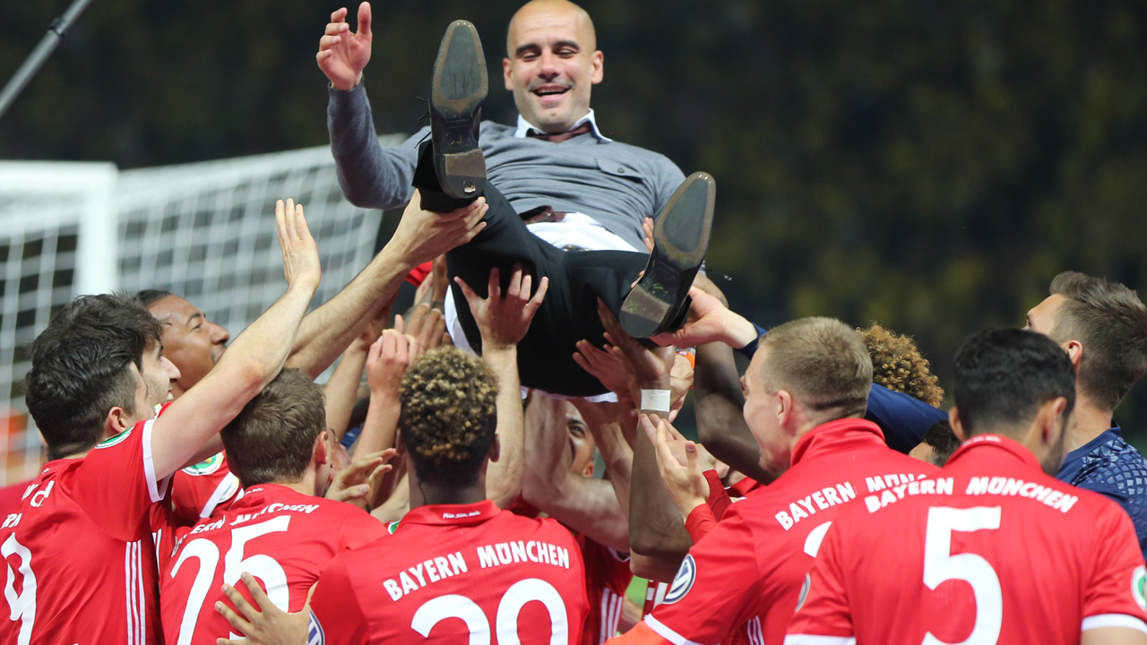 Bayern Munich's Spanish head coach Pep Guardiola is thrown in the air by his players after the German Cup (DFB Pokal) final football match Bayern Munich vs Borussia Dortmund at the Olympic stadium in Berlin on May 21, 2016. Bayern Munich won the German Cup. / AFP PHOTO / DPA / Kay Nietfeld / Germany OUT