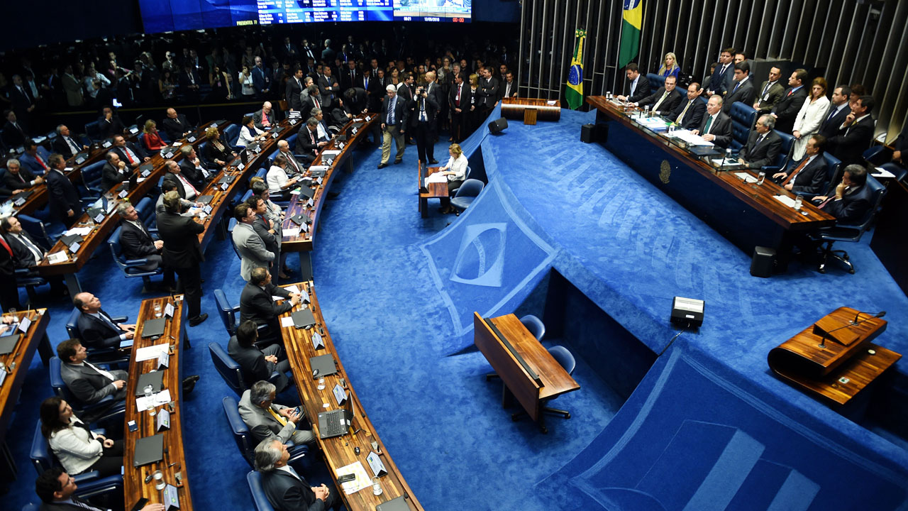 The final score of a Senate vote with an overwhelming 55-22 on suspending Brasilian President Dilma Rousseff and launching an impeachment trial is pictured on a large screen inside the Senate in Brasilia on May 12, 2016. Brazilian President Dilma Rousseff was suspended on May 12 to face impeachment, ceding power to her vice-president-turned-enemy Michel Temer in a political earthquake ending 13 years of leftist rule over Latin America's biggest nation. / AFP PHOTO / EVARISTO SA