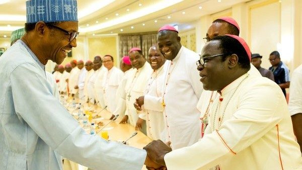 President Muhammadu Buhari shaking hands with Rev Mathew Kukah when he received a contingent of Nigerian Catholic Bishops at the Presidential Villa, Abuja on Monday, May 2, 2016. PHOTO: STATE HOUSE