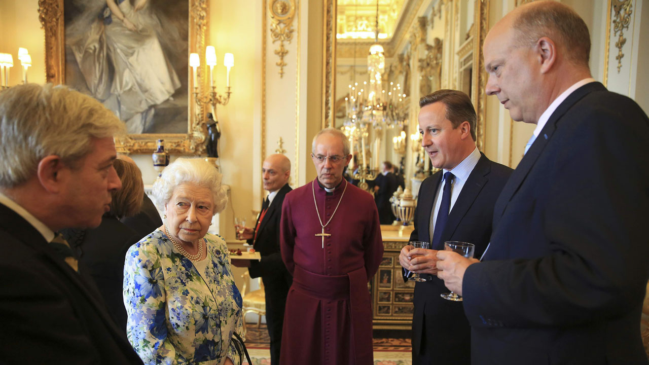 Speaker of the House of Commons John Bercow (L) speaks to Britain's Queen Elizabeth II as British Prime Minister David Cameron (2nd R), Chris Grayling (R), Leader of the British House of Commons and The Archbishop of Caterbury, Justin Welby (C) look on during a reception in Buckingham Palace in London on May 10, 2016. Delegations from both Houses of Parliament, comprised of representatives from across the political spectrum visited The Queen at Buckingham Palace to mark her 90th Birthday. / AFP PHOTO / POOL / PAUL HACKETT