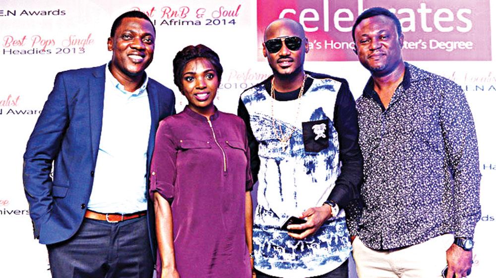 Abayomi Ajao (left), Annie Idibia, Campari Ambassador, 2Baba and CEO, NowMuzik, Efe Omorogbe at the Campari celebration of 2Baba honorary masters degree at Rumours Nite Club, Ikeja, Lagos.