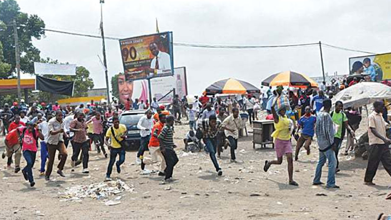 Protesters run after Democratic Republic of Congo soldiers opened fire to disperse them.