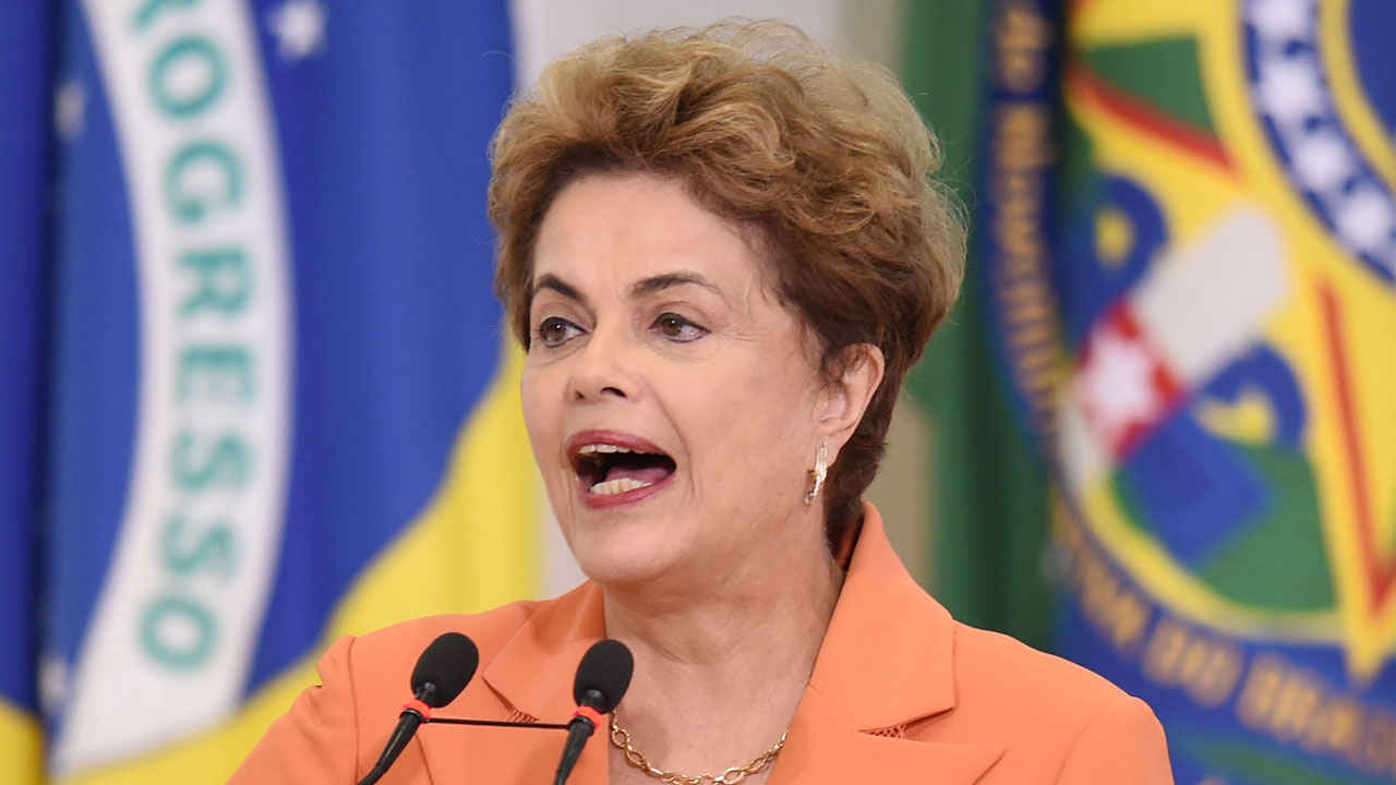 Brazilian President Dilma Rousseff delivers a speech during the launching of the Agricultural and Livestock Plan for 2016/2017, at Planalto Palace in Brasilia, on May 4, 2016. Rousseff is fighting impeachment on allegations that she illegally borrowed money to boost public spending during her 2014 re-election campaign. / AFP PHOTO / EVARISTO SA