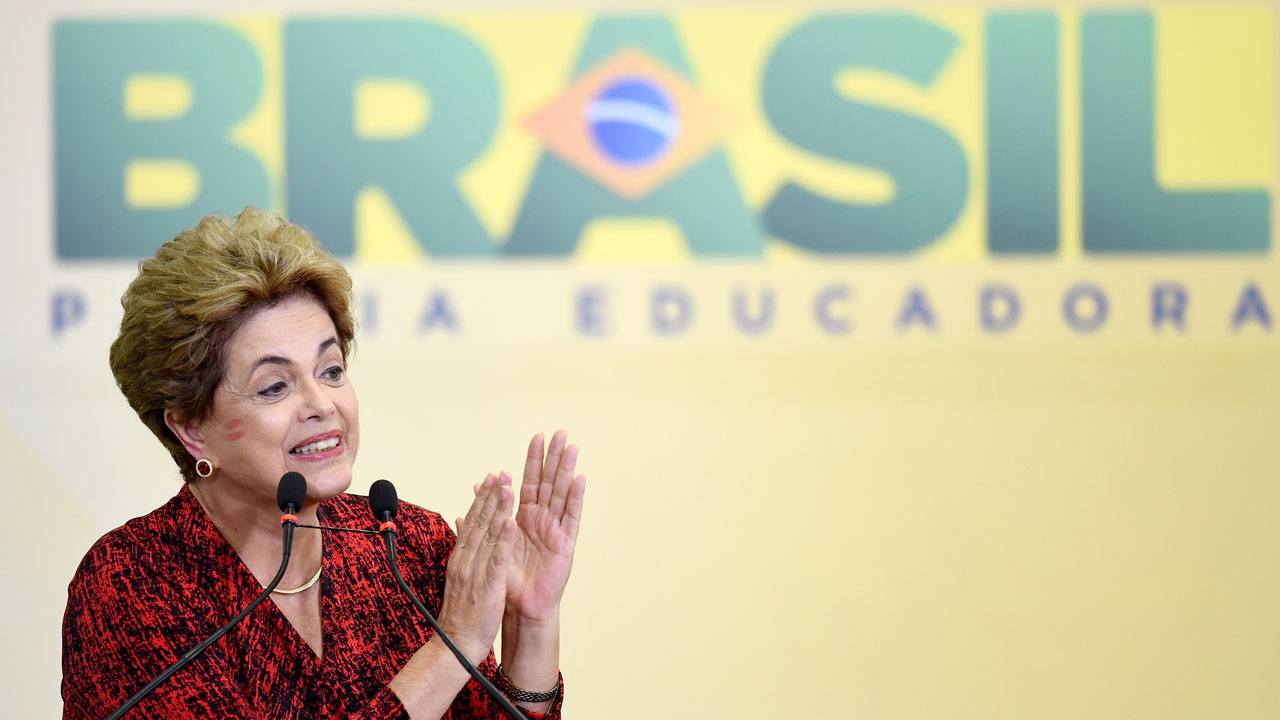 Brazilian President Dilma Rousseff  during a ceremony to announce the creation of new public universities, at  Planalto Palace in Brasilia, on May 9, 2016. The impeachment of Brazilian President Dilma Rousseff was thrown into confusion when Waldir Maranhao, the interim speaker of the lower house of Congress annulled on May 9, 2016 an April vote by lawmakers to launch the process. He wrote in an order that a new vote should take place on whether to impeach Rousseff.  / AFP PHOTO / EVARISTO SA